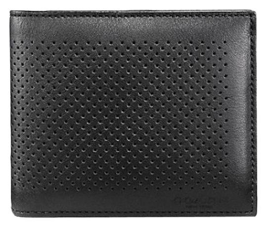 Preload https://item1.tradesy.com/images/coach-black-compact-id-perforated-leather-wallet-23366600-0-3.jpg?width=440&height=440