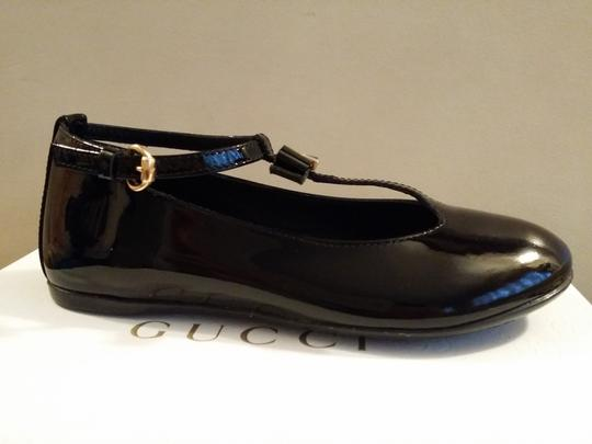 Preload https://item2.tradesy.com/images/gucci-black-new-kids-patent-t-strap-27-us-105-285313-shoes-23366781-0-0.jpg?width=440&height=440