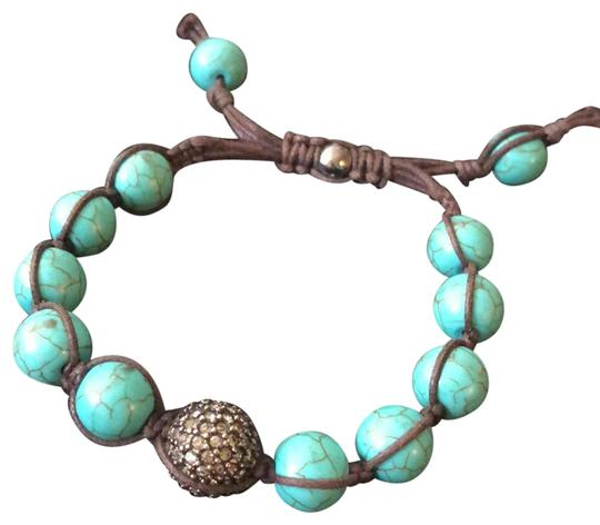 Preload https://img-static.tradesy.com/item/23366828/turquoise-adjustable-beaks-and-leather-bracelet-0-1-540-540.jpg