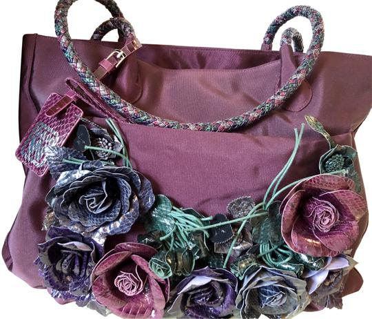 Preload https://img-static.tradesy.com/item/23367032/unique-flowers-plum-nylon-and-leather-tote-0-1-540-540.jpg