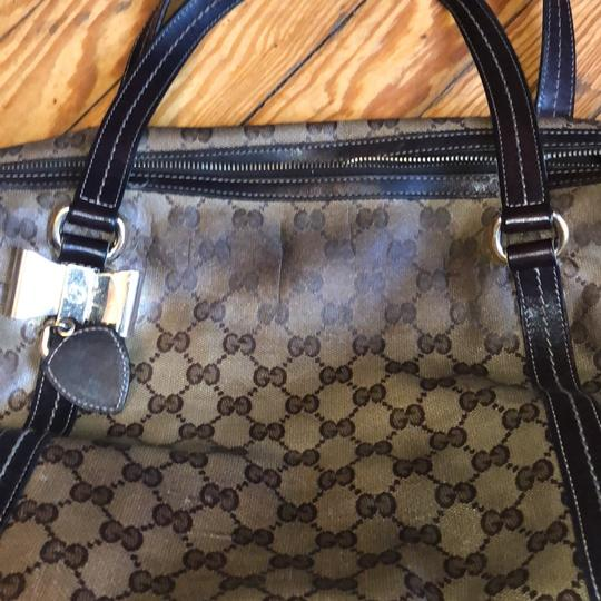Gucci Brown and beige with gold hardware Travel Bag