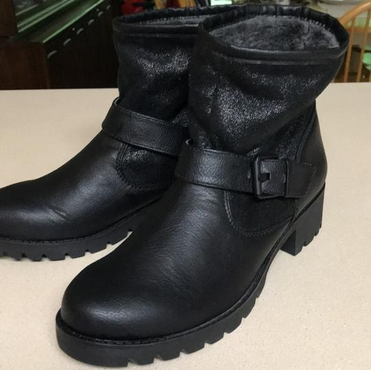 Preload https://item2.tradesy.com/images/aldo-black-chunky-combat-bootsbooties-size-us-9-regular-m-b-23367196-0-0.jpg?width=440&height=440