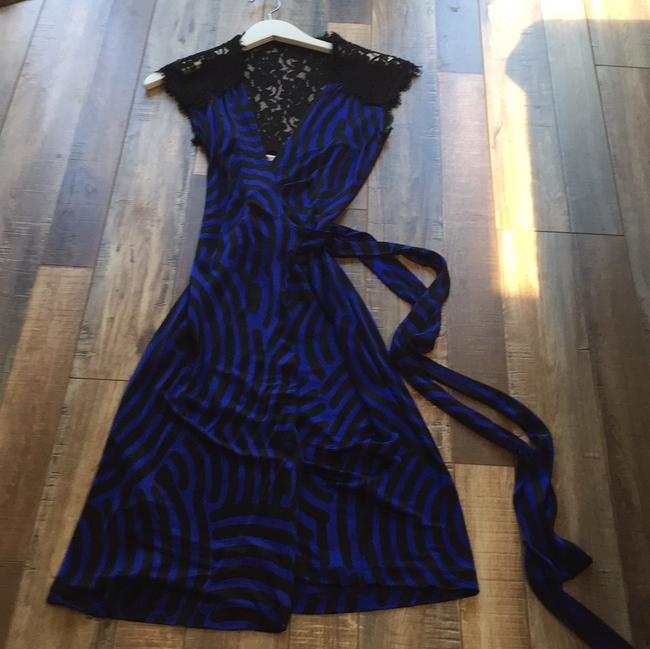 Preload https://img-static.tradesy.com/item/23368218/diane-von-furstenberg-black-and-blue-dvf-lace-sleeveless-wrapped-mid-length-cocktail-dress-size-4-s-0-4-650-650.jpg