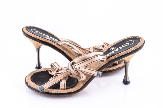 Preload https://img-static.tradesy.com/item/23369204/chanel-gold-satin-ribbon-cork-slide-sandals-size-us-7-regular-m-b-0-0-540-540.jpg