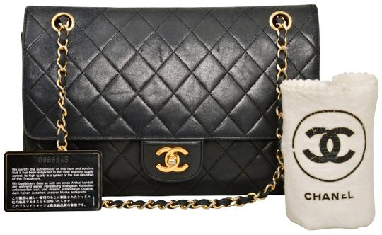 Preload https://item2.tradesy.com/images/chanel-105-inch-vintage-double-flap-black-quilted-lambskin-leather-shoulder-bag-23370496-0-0.jpg?width=440&height=440
