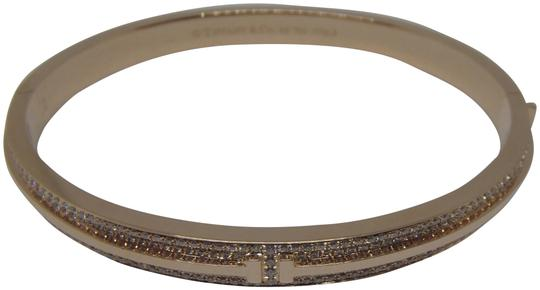Preload https://img-static.tradesy.com/item/23375279/tiffany-and-co-18k-rose-gold-and-diamonds-t-two-hinged-bracelet-0-1-540-540.jpg