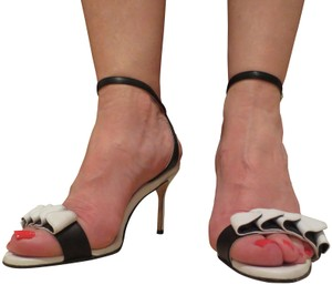 4c24805df691 US 9.5. Sold Out. Sarah Flint Black   White Sandals
