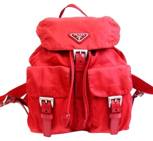 258034ce1293 Added to Shopping Bag. Prada Backpack. Prada Red Vela Mini Backpack