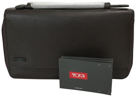 Preload https://img-static.tradesy.com/item/23382540/tumi-new-rfid-protection-travel-document-holder-brown-leather-clutch-0-1-540-540.jpg
