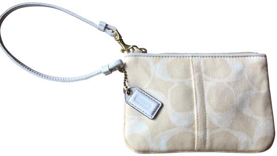 Preload https://img-static.tradesy.com/item/23382705/coach-small-signature-print-ivory-and-gold-canvas-wristlet-0-1-540-540.jpg