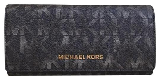 Preload https://img-static.tradesy.com/item/23382749/michael-kors-brown-plum-logo-jet-set-carryall-leather-wallet-0-1-540-540.jpg