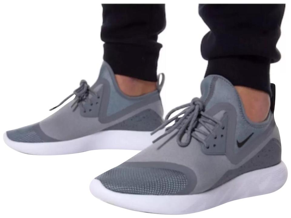 ad36c12a2ecf Nike Women s Lunarcharge Essential Grey Sneakers Features A Comfortable  Neoprene Boot Construction. Style Color  Sneakers