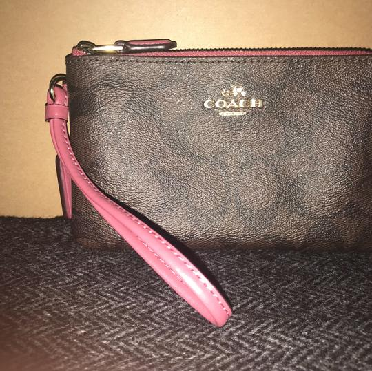 Coach Wristlet in brown/ Rouge