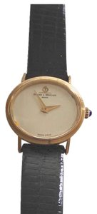 Baume & Mercier Classic 18k women's wristwatch with oval face, circa 1980's. Swiss made