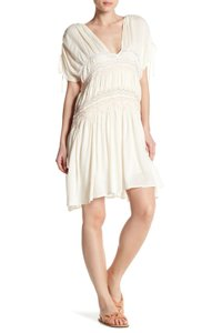 Free People short dress ivory Embroidered Tie Short Sleeve V-neck Cinched on Tradesy