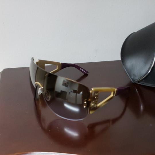 Dior Christian Dior sunglasses in tortishell and eggplant with Dior on the earpieces. Image 10