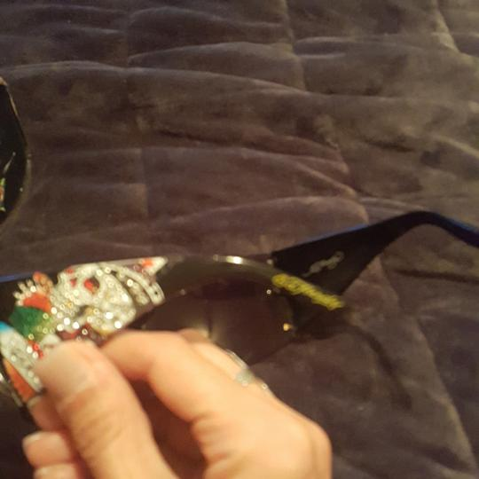 Ed Hardy Ed Hardy sunglasses limited edition with both earpieces inlaid with sworsky crystals and signature Ed Hardy art. Case and extra crystals included Image 4
