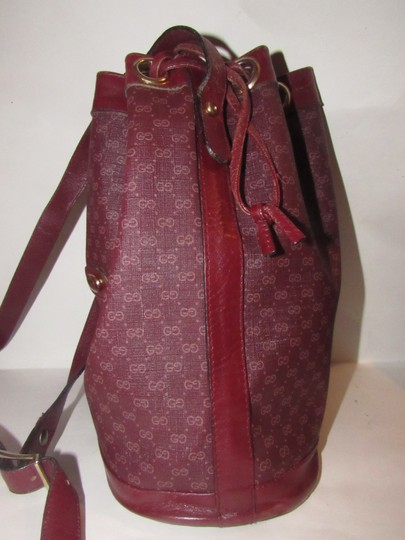 Gucci Drawstring Top Bucket Style Mint Vintage Color Has Dust Satchel in light ox-blood small G logo print on burgundy coated canvas and burgundy leather Image 1