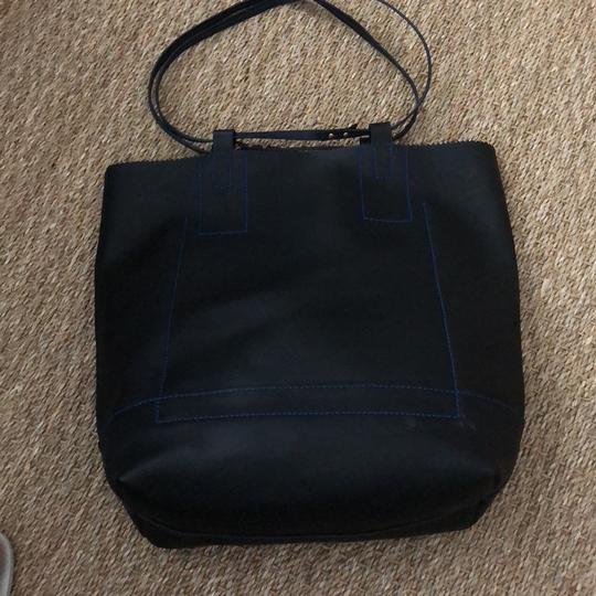 Nanette Lepore Tote in black leather with royal blue suede interior Image 3