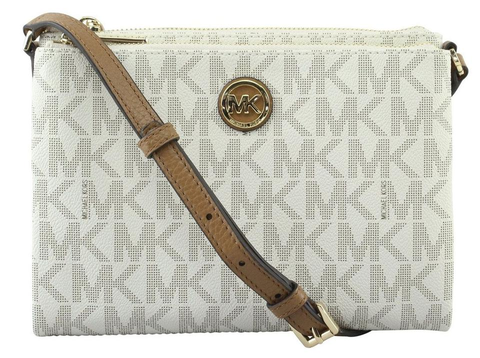 611f0117d7b1 Michael Kors Fulton East West White Canvas Cross Body Bag - Tradesy