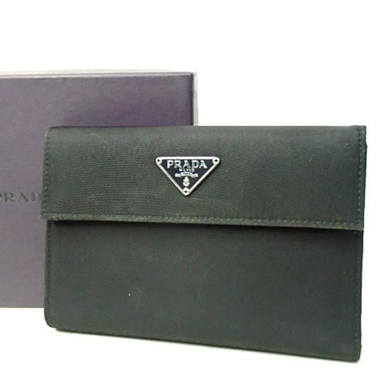 Preload https://img-static.tradesy.com/item/23417012/prada-black-tessuto-nylon-saffiano-leather-medium-bifold-wallet-0-0-540-540.jpg