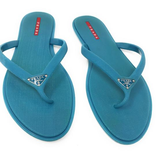 Preload https://img-static.tradesy.com/item/23417270/prada-blue-flops-sandals-size-eu-40-approx-us-10-regular-m-b-0-0-540-540.jpg