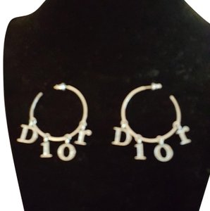 """Dior Dior Sterling silver and sworsky crystal earrings 1""""hoops. Pair with necklaces and ring in my closet. A,few missing crystals, but not noticeable when wearing. ."""