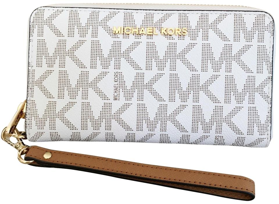 buy online 4e6f7 7a32d Michael Kors Multifunction Phone Case Wallet White Leather Wristlet 42% off  retail