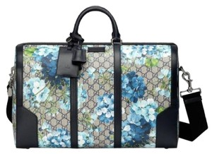 fd89bd90df9d Added to Shopping Bag. Gucci Beige/Blue Gg Coated Canvas Reversible 406380  8496 Beige/Blue Travel Bag. Gucci Duffle Bloom ...