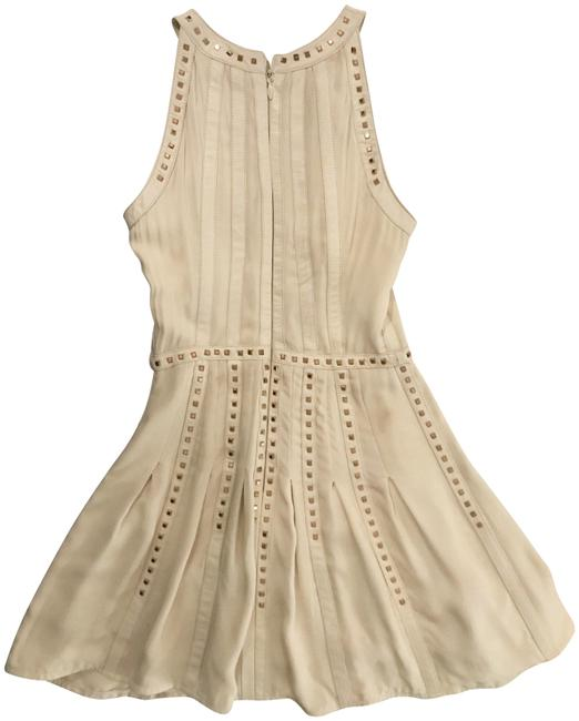 Preload https://img-static.tradesy.com/item/23435591/bebe-ivoryrose-gold-chiffon-and-leather-new-without-tags-short-cocktail-dress-size-00-xxs-0-1-650-650.jpg