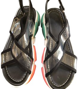 Knowlesandcompany black and transparent top with multi color sole. Sandals