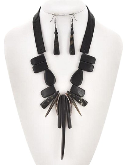Preload https://img-static.tradesy.com/item/23442803/black-hematite-tone-wood-and-leatherette-and-shell-earring-set-necklace-0-1-540-540.jpg