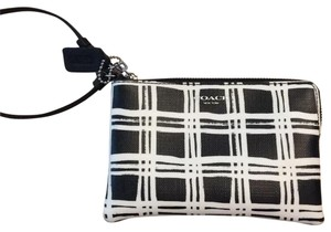 Coach Wristlet in Black and white exterior, blue interior