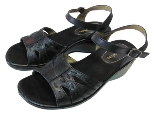 Preload https://item2.tradesy.com/images/black-leather-wedges-size-us-7-narrow-aa-n-2344921-0-0.jpg?width=440&height=440