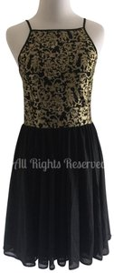 Romeo & Juliet Couture short dress Black & Gold on Tradesy