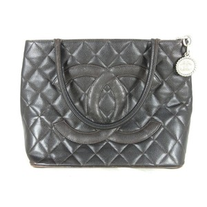 Chanel Quilted Gold Tote in Black
