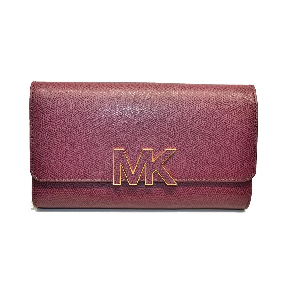 aa874d8060a7 ... germany michael kors plum florence large billfold emb leather clutch  wallet f52af c67ed