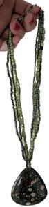 Artistry Green artisan necklace with brown, beige, white and silver accents