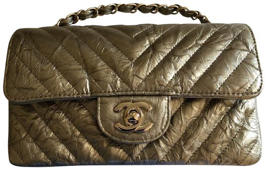 Preload https://img-static.tradesy.com/item/23468193/chanel-classic-mini-rectangular-chevron-quilted-flap-gold-with-gold-hardware-crumpled-patent-leather-0-1-540-540.jpg