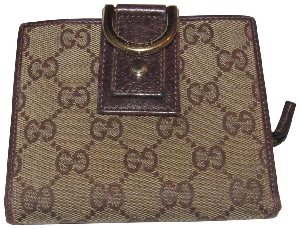 6ec35273e67f Gucci Brown Large G Logo Print Coated Canvas and Brown Leather with A Gold  Abbey D Ring Accent Vintage Wallet/Designer Wallet