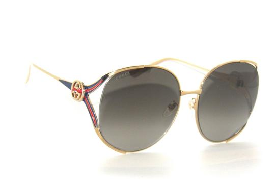 Preload https://item3.tradesy.com/images/gucci-gold-gg0225s-002-round-red-and-blue-temple-sunglasses-23476322-0-0.jpg?width=440&height=440