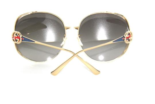 Gucci Gucci GG0225S 002 Gold Round Sunglasses Red and Blue Temple