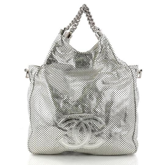 Preload https://item2.tradesy.com/images/chanel-hobo-rodeo-drive-perforated-small-silver-metallic-leather-hobo-bag-23476366-0-0.jpg?width=440&height=440