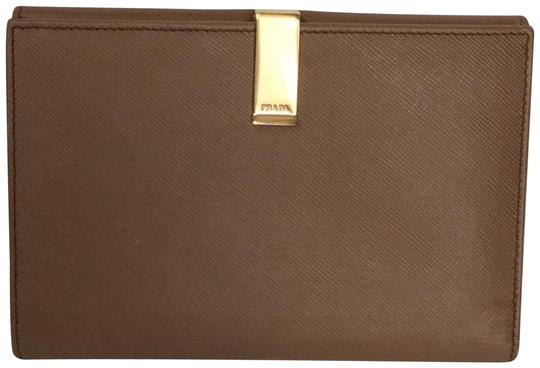 Preload https://img-static.tradesy.com/item/23476370/prada-caramel-color-bifold-organizer-wallet-0-2-540-540.jpg