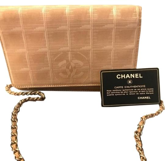 Preload https://item2.tradesy.com/images/chanel-wallet-on-chain-cream-leathercanvas-shoulder-bag-23476381-0-1.jpg?width=440&height=440