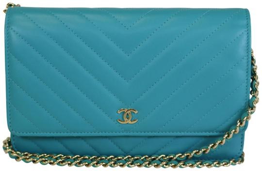 Preload https://item2.tradesy.com/images/chanel-wallet-on-chain-chevron-turquoise-lambskin-cross-body-bag-23476611-0-1.jpg?width=440&height=440