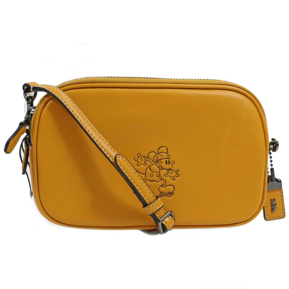 7e3eec66fff9 Coach Disney Limited Edition Mickey Mouse Clutch Yellow Smooth ...