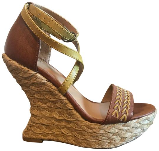 Preload https://img-static.tradesy.com/item/23482985/mossimo-supply-co-brown-and-gold-boho-wedge-sandals-size-us-55-regular-m-b-0-1-540-540.jpg