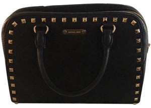 MICHAEL Michael Kors Satchel in black leather with gold stud trim.