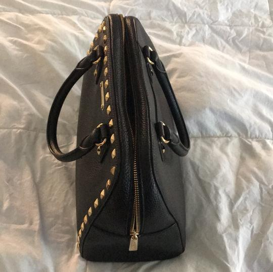 MICHAEL Michael Kors Satchel in black leather with gold stud trim. Image 1